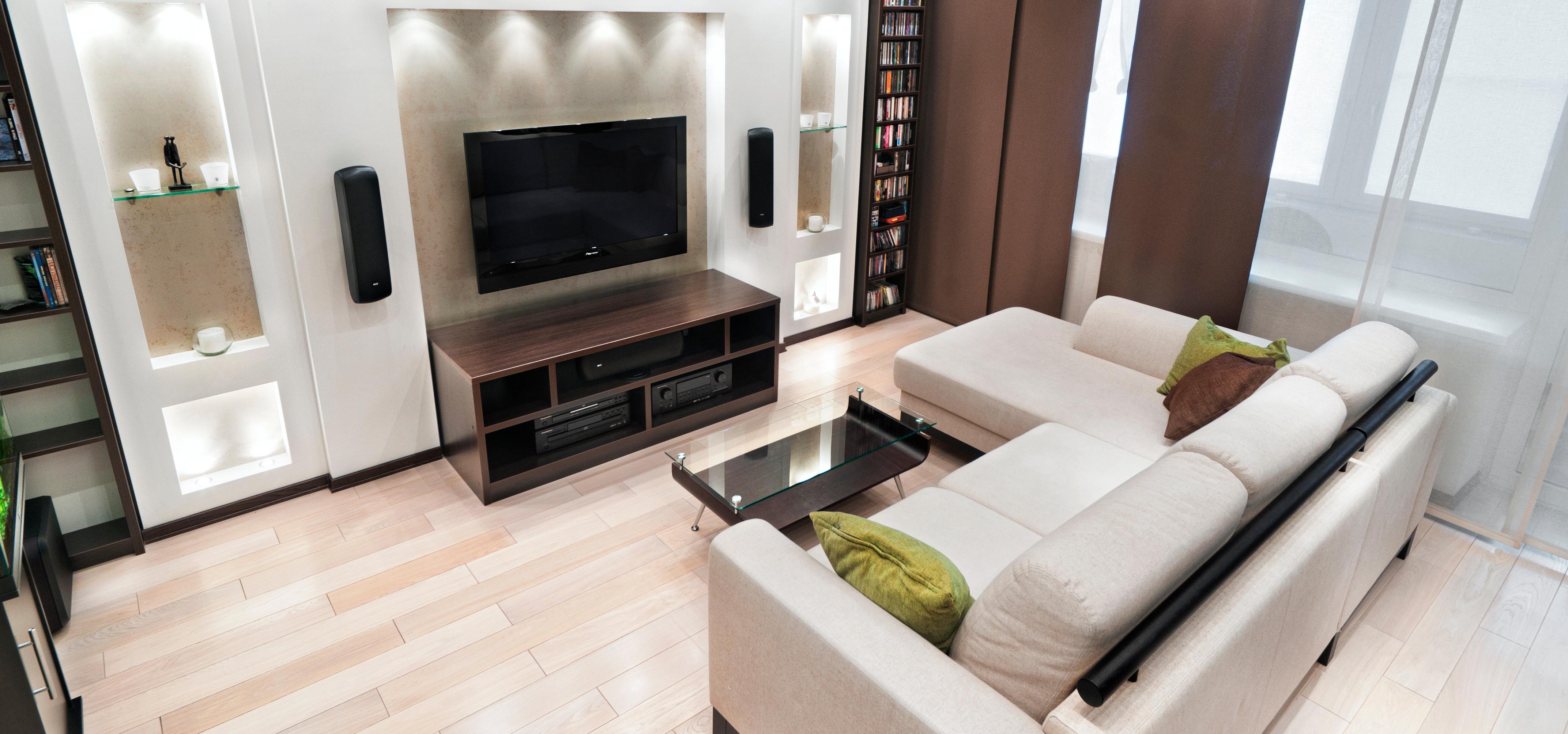 Дизайн зала с угловым диваном